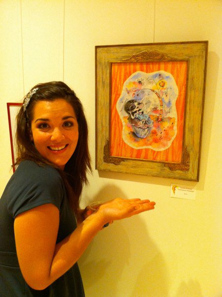 Laurel Scribner with her Art piece at a Gallery event